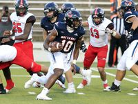 Sachse QB Alex Orji (10) picks up a couple of yards in a crowd during the first half of a high school football game against Denton Braswell at Homer B Johnson Stadium in Garland on Thursday, September 9, 2021.