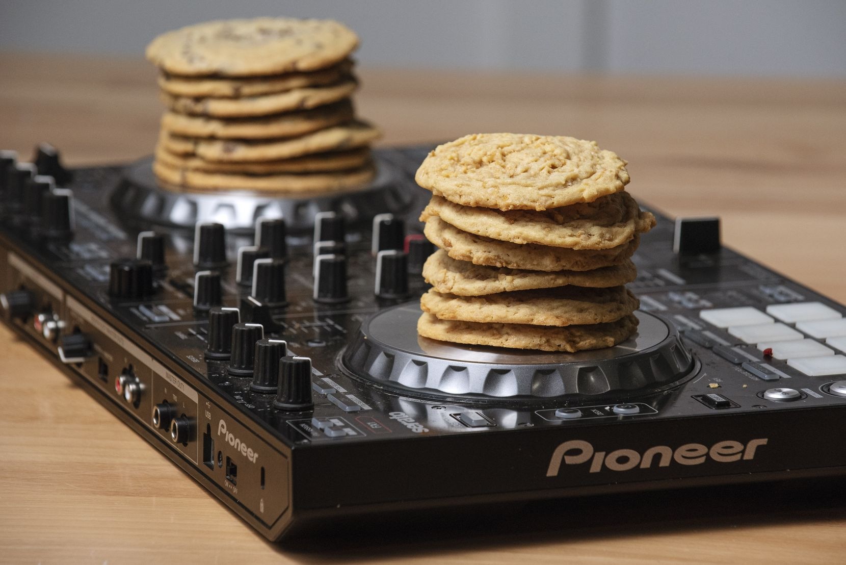Stacks of Frosted Flake, right, and chocolate chip cookies on the electronic turntables of DJ Ursa Minor, photographed at Tyler Station in Dallas, on Monday, Oct. 19, 2020.