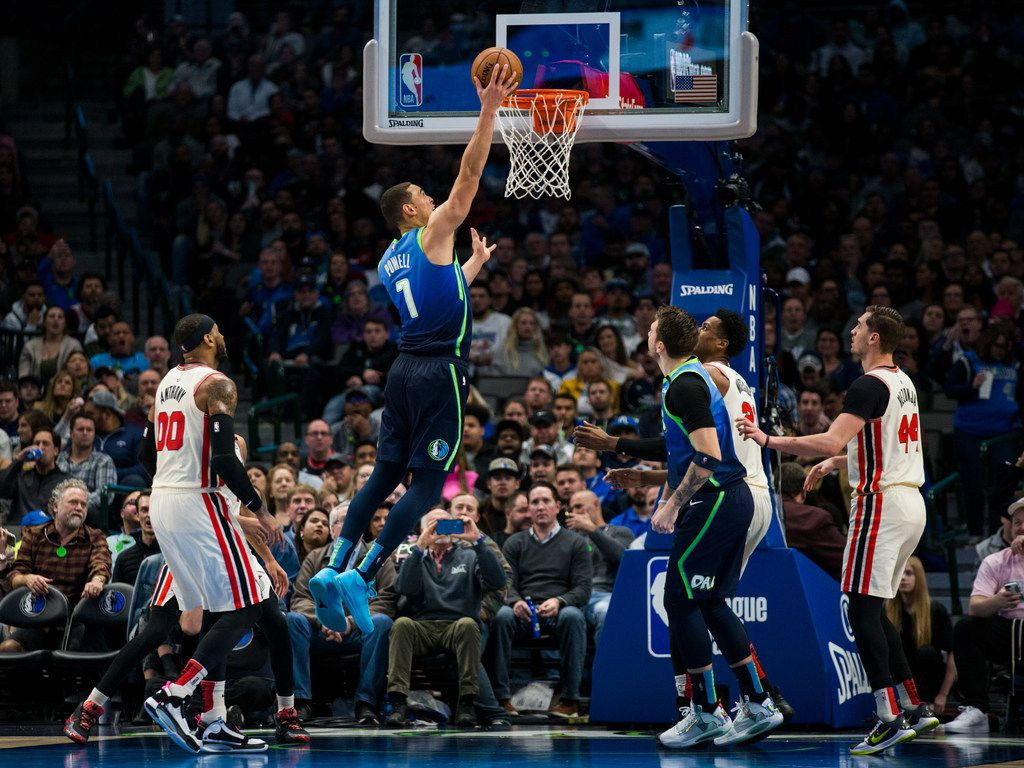 Dallas Mavericks forward Dwight Powell (7) goes up for a basket during the third quarter of an NBA game between the Dallas Mavericks and the Portland Trail Blazers on Friday, January 17, 2020 at American Airlines Center in Dallas.