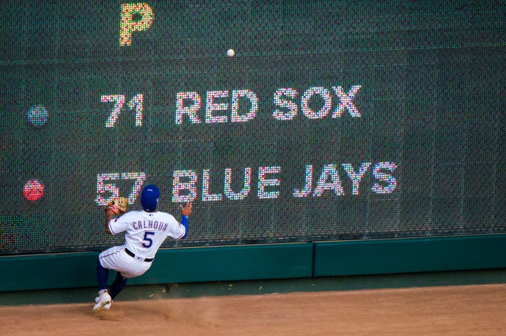 Texas Rangers outfielder Willie Calhoun canÕt make the play on a run-scoring double off the bat of Tampa Bay Rays designated hitter Tommy Pham during the first inning at Globe Life Park on Wednesday, Sept. 11, 2019, in Arlington. (Smiley N. Pool/The Dallas Morning News)