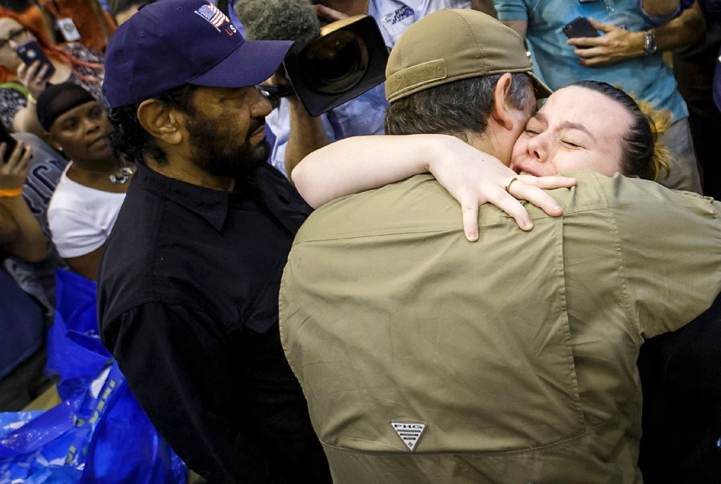 Hurricane Harvey evacuee Jennifer Nixon hugs U.S. Sen. Ted Cruz while he toured with U.S. Rep. Al Green, left, and others the evacuation center at NRG Center on Monday, Sept. 4, 2017, in Houston. A group of elected officials met with evacuees and held a brief news conference in an effort to drum up support for emergency aid for Harvey victims. (Smiley N. Pool/The Dallas Morning News)