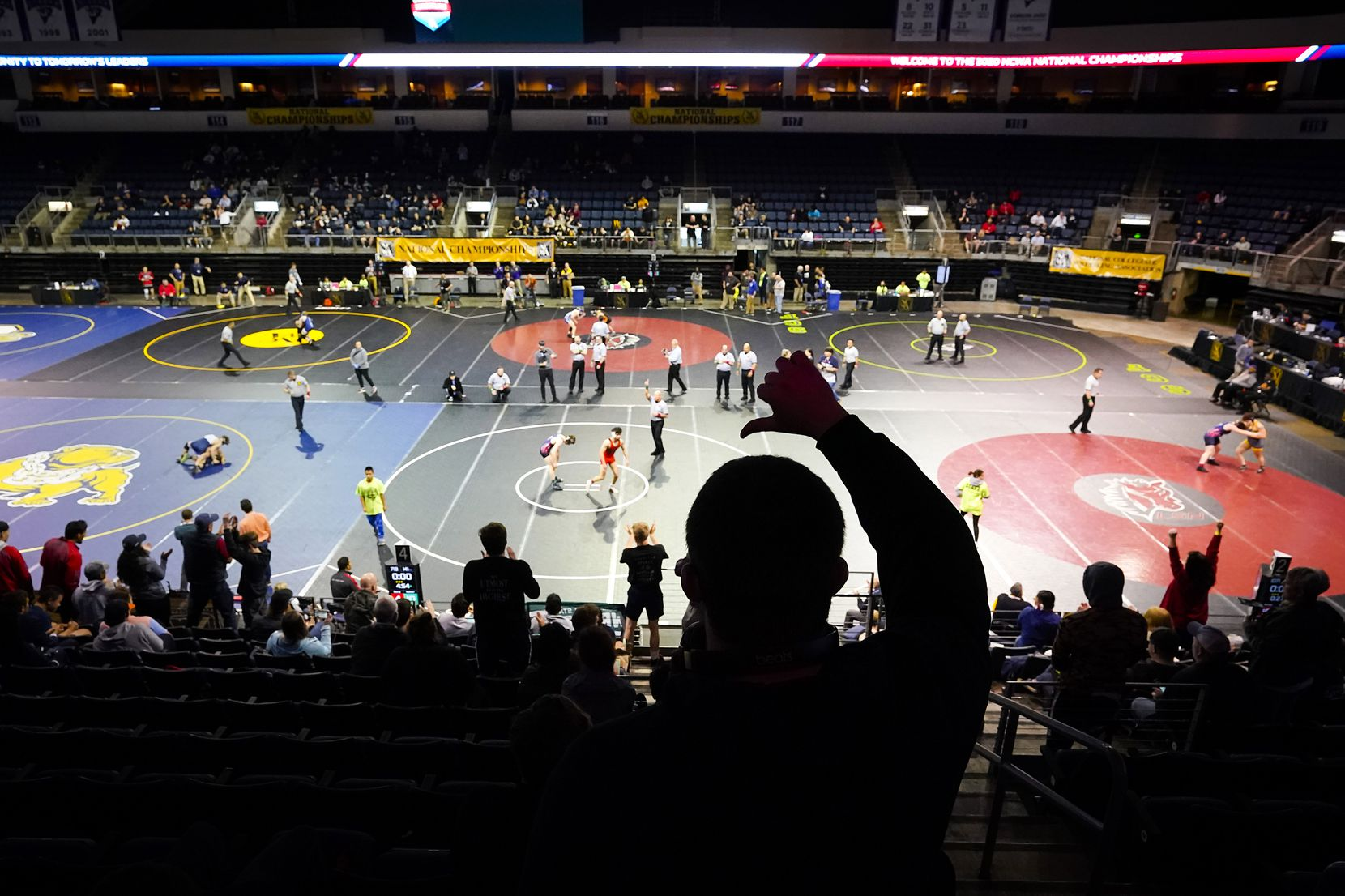 A fan gives a thumbs down to a referees decision during the NCWA national championships at the Allen Events Center on Friday, March 13, 2020, in Allen, Texas.