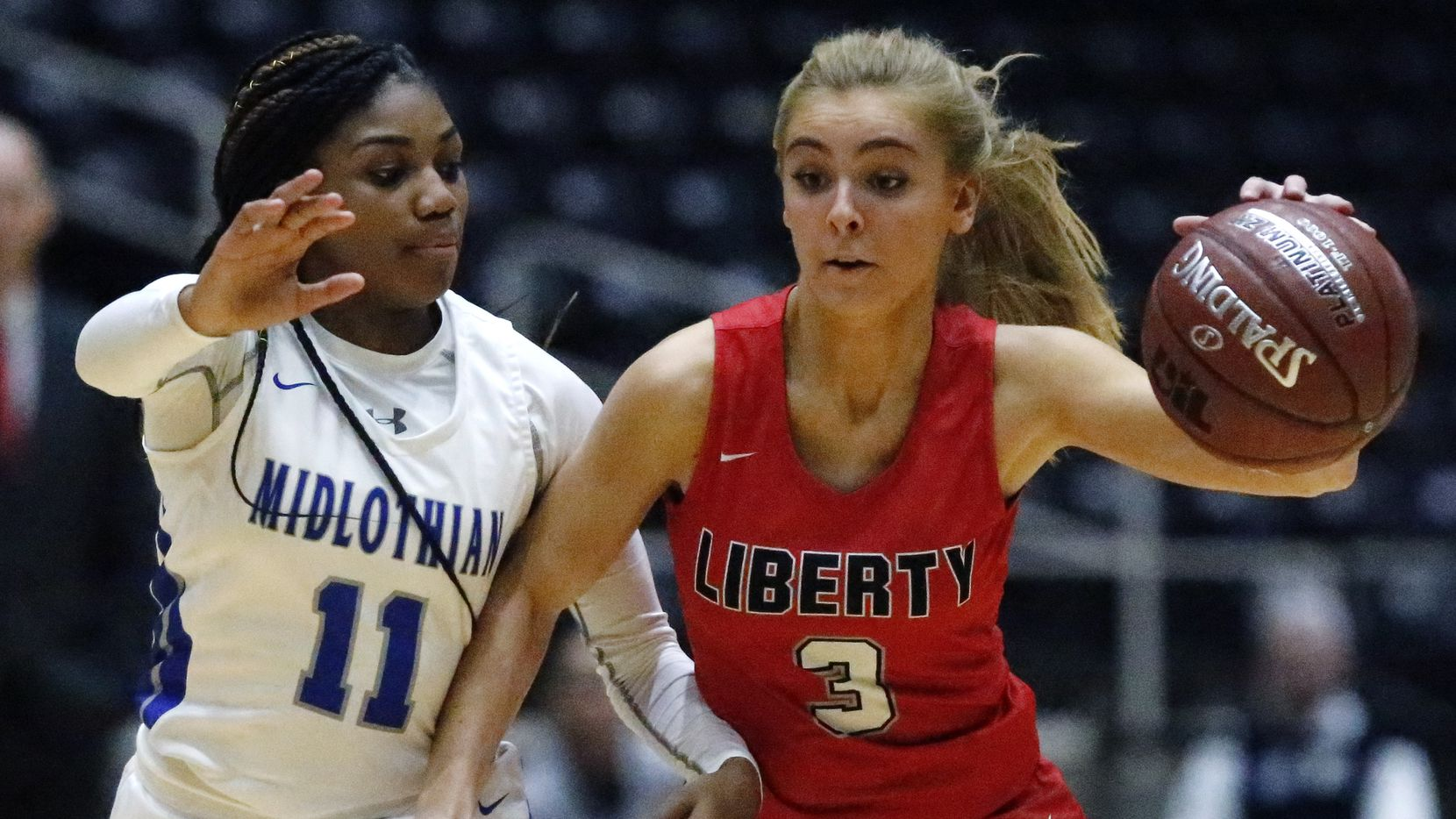Midlothian High School guard Maykayla Jackson (11) defends Frisco Liberty High School guard Lily Ziemkiewicz (3) during the first half as Midlothian High School hosted Frisco Liberty High School in the Class 5A Region II championship girls basketball game at the Curtis Culwell Center in Garland on Saturday, February 29, 2020.
