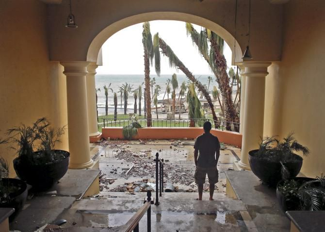 A tourist looked out from the debris-filled Hilton hotel in Los Cabos, Mexico, after Hurricane Odile made landfall in the area early Monday. Officials said 135 people had minor injuries, but no deaths were reported.