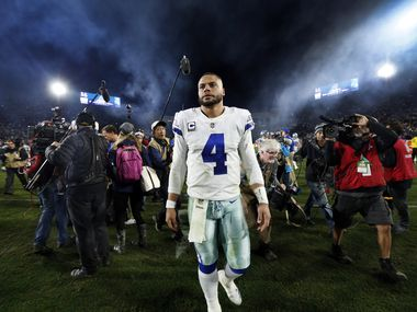FILE — Dallas Cowboys quarterback Dak Prescott (4) leaves the field after losing to the Los Angeles Rams in their NFC Divisional Playoff game at Los Angeles Memorial Coliseum in Los Angeles, Saturday, January 12, 2019. The Cowboys lost 30-22.