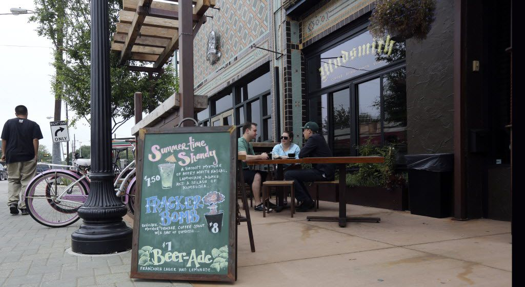 Mudsmith, a local coffee shop, opened in January 2013 on lower Greenville Ave. Seated from left, Ben Alves, Vyktoria Alves, Kyle Zibell, enjoy the patio early Wednesday  morning, May 1, 2013.