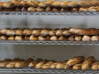 Freshly-baked baguettes sit on a shelf at the Empire Baking Company on East University Drive in Dallas.