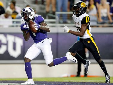 TCU Horned Frogs wide receiver Jalen Reagor (1) pulls in a long touchdown reception in front of Arkansas-Pine Bluff Golden Lions defensive back Jordan Brown (29) during the third quarter at Amon G. Carter Stadium in Fort Worth Texas, Saturday, August 31, 2019. TCU defeated Arkansas-Pine Bluff, 39-7.