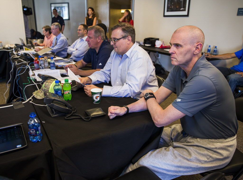 Dallas Mavericks general manager Donnie Nelson (second from right) and head coach Rick Carlisle (right) talk draft picks in their draft room during the Dallas Mavericks 2016 NBA draft party on Thursday, June 23, 2016 at the American Airlines Center in Dallas.  (Ashley Landis/The Dallas Morning News)