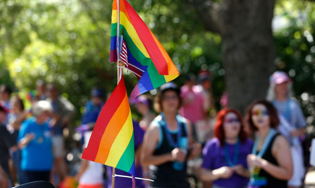 Rainbow flags and an American flag fly at Dallas' LGBT pride parade on Turtle Creek Boulevard in Dallas on Sept. 18, 2016. (Jae S. Lee/The Dallas Morning News)