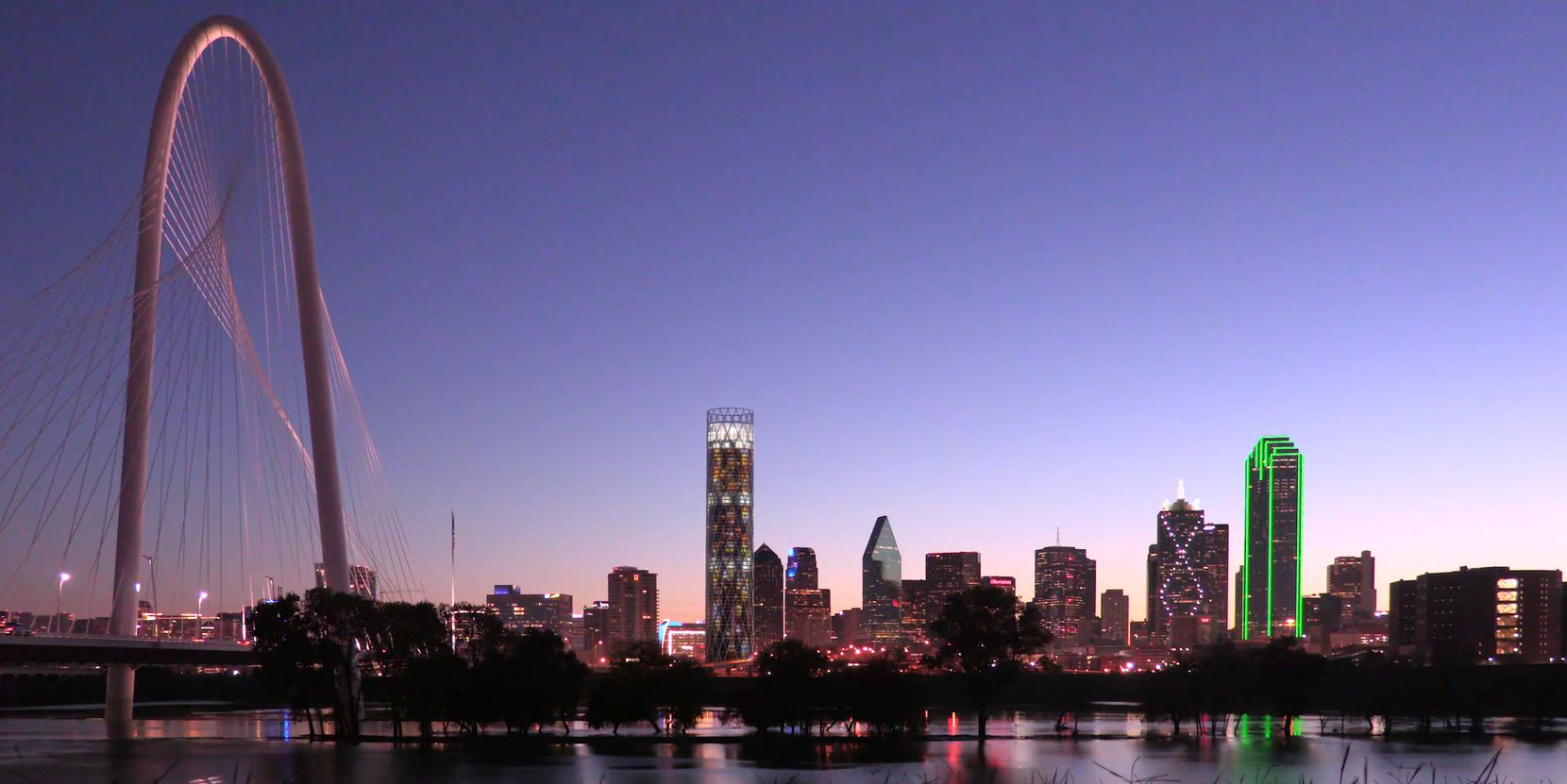 An architect's rendering shows the proposed tower on the Dallas skyline.