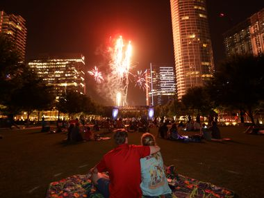 First responders and their families watch fireworks at Klyde Warren Park in Dallas, TX, on Jun. 27, 2020. (Jason Janik/Special Contributor)