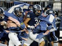 Flower Mound High School defensive end Luke Browning (34) hits the run through as his team enters onto the field as Flower Mound High School hosted Plano East High School at Wilson/Jaguar Stadium in Flower Mound on Friday night, October 15, 2021. (Stewart F. House/Special Contributor)