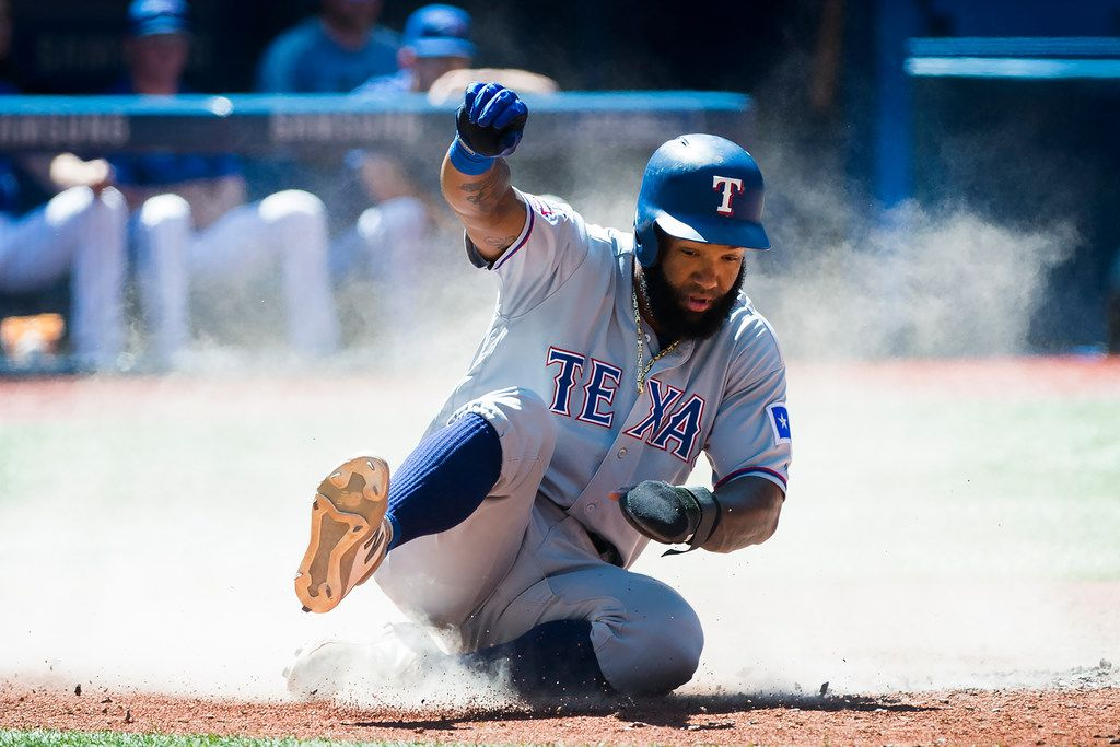 Texas Rangers' Danny Santana scores against the Toronto Blue Jays during the sixth inning of a baseball game in Toronto, Wednesday, Aug. 14, 2019. (Nathan Denette/The Canadian Press via AP)