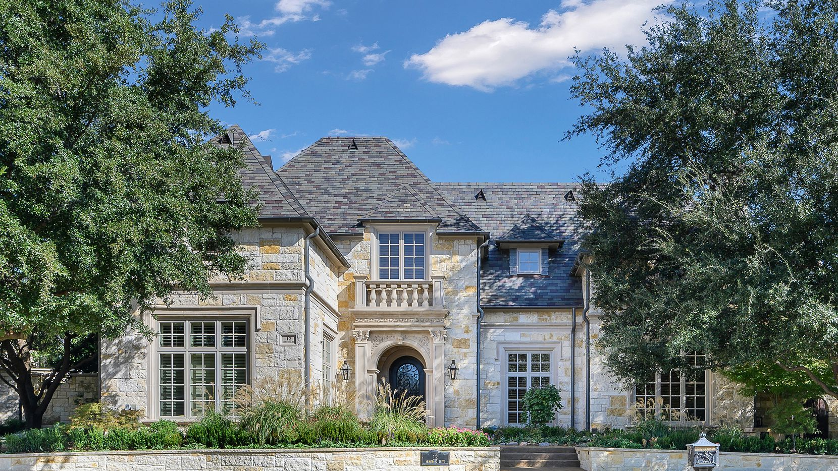 Priced at $1,649,000, the country French-style estate at 12 Armstrong Drive in The Villages of Stonebriar Park offers a park-like setting.