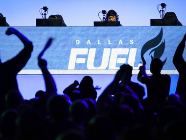 Fans cheer as Noh ÒGamsuÓ Youngjin of the Dallas Fuel (center) and his teammates compete in an Overwatch League match against the Los Angeles Valiant at the Arlington Esports Stadium on Saturday, Feb. 8, 2020, in Arlington.
