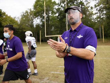 Stephen F. Austin Lumberjacks coach Colby Carthel wears a face shield during practice in Nacogdoches on Thursday, Oct. 8, 2020. (Juan Figueroa/ The Dallas Morning News)