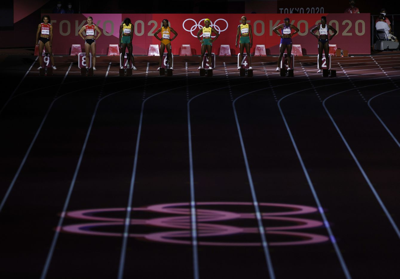 Light display during the introductions for the women's 100 meter final race during the postponed 2020 Tokyo Olympics at Olympic Stadium, on Saturday, July 31, 2021, in Tokyo, Japan. Jamaica's Elaine Thompson-Herah earned a gold medal in the race.  (Vernon Bryant/The Dallas Morning News)