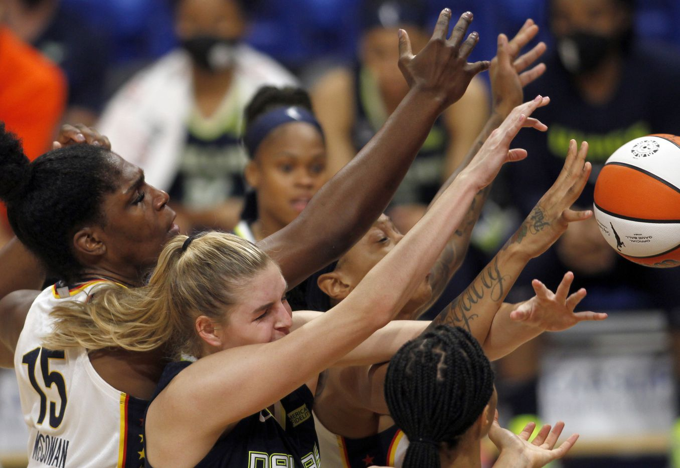 Dallas Wings center Bella Alarie (32), lower center, winces as she finds herself competing with several Indiana Fever players, including Teaira McCowen (15), far left, for a rebound during first half action. The Wings lost to the Fever 83-81.The Dallas Wings hosted the Indiana Fever for their WNBA game held at College Park Center on the campus of UT-Arlington on August 20, 2021. (Steve Hamm/ Special Contributor)