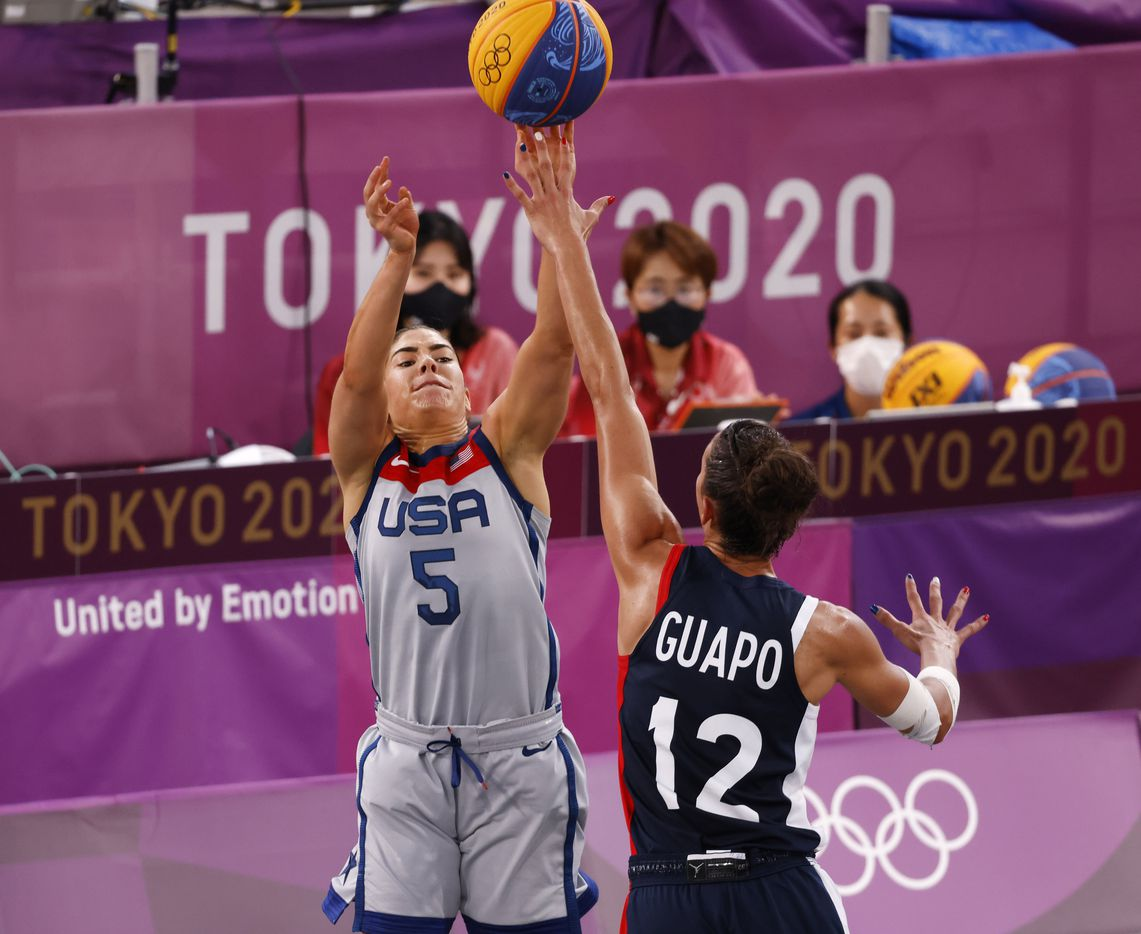 USA's Kelsey Plum (5) shoots over the reach of France's Laetitia Guapo (12) in a 3x3 women's basketball game during the postponed 2020 Tokyo Olympics at Aomi Urban Sports Park on Saturday, July 24, 2021, in Tokyo, Japan. USA defeated France 17-10 in the game. (Vernon Bryant/The Dallas Morning News)
