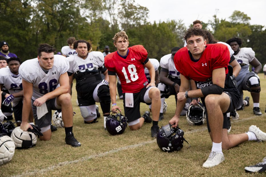 Stephen F. Austin Lumberjacks quarterback Trae Self (right) and other players join in a huddle as they listen to coach Colby Carthel after practice in Nacogdoches on Thursday, Oct. 8, 2020 . (Juan Figueroa/ The Dallas Morning News)