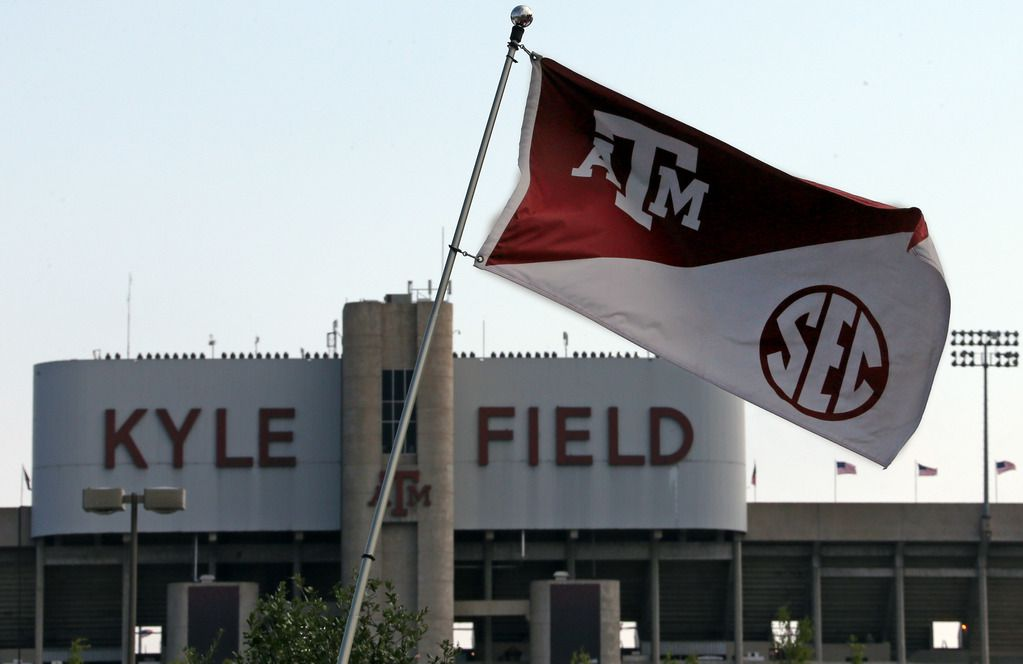 Texas A&M flags bearing the SEC logo bristle in the steady breeze outside Kyle Field before the University of Florida Gators vs. the Texas A&M Aggies NCAA college football game at Kyle Field in College Station on Saturday, September 8, 2012. (Louis DeLuca/The Dallas Morning News)