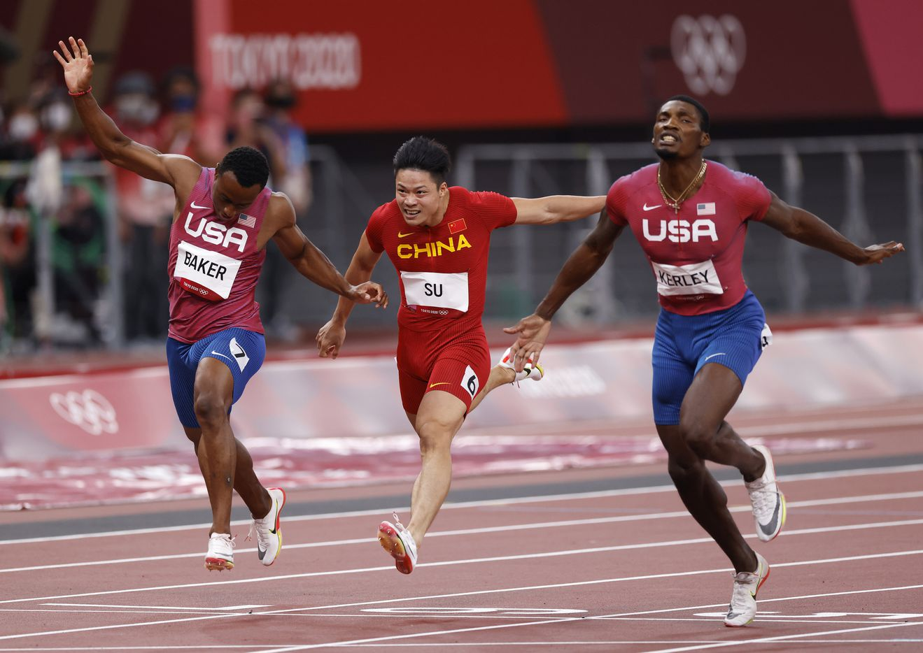 USA's Ronnie Baker, Su Bingtian, and Fred Kerley race to the finish in the men's 100 meter final during the postponed 2020 Tokyo Olympics at Olympic Stadium, on Sunday, August 1, 2021, in Tokyo, Japan. Kerley took second place with a time of 9.84 seconds. Baker took 5th and Bingtian took 6th place. (Vernon Bryant/The Dallas Morning News)