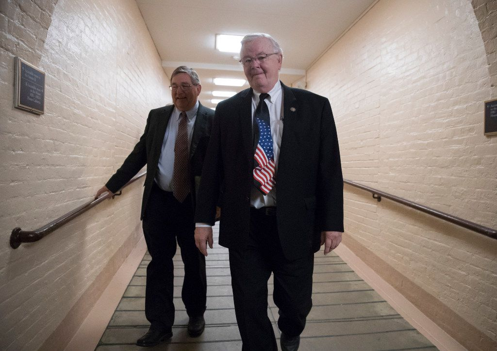 Rep. Michael Burgess (left), R-Texas, and Rep. Joe Barton, R-Texas, walked to a meeting with fellow House Republicans earlier this month as work in Congress resumed after the August recess.