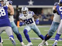 Dallas Cowboys running back Tony Pollard (20) looks for a hole in the offensive line during the fourth quarter against the New York Giants at AT&T Stadium in Arlington, Texas, Sunday, October 10, 2021.