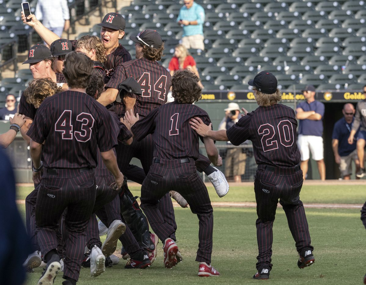 Members of the Rockwall-Heath Hawks celebrate their state victory over Keller during the 2021 UIL 6A state baseball final held, Saturday, June 12, 2021, in Round Rock, Texas.  Rockwall-Heath defeated Keller 4-3.   (Rodolfo Gonzalez/Special Contributor)