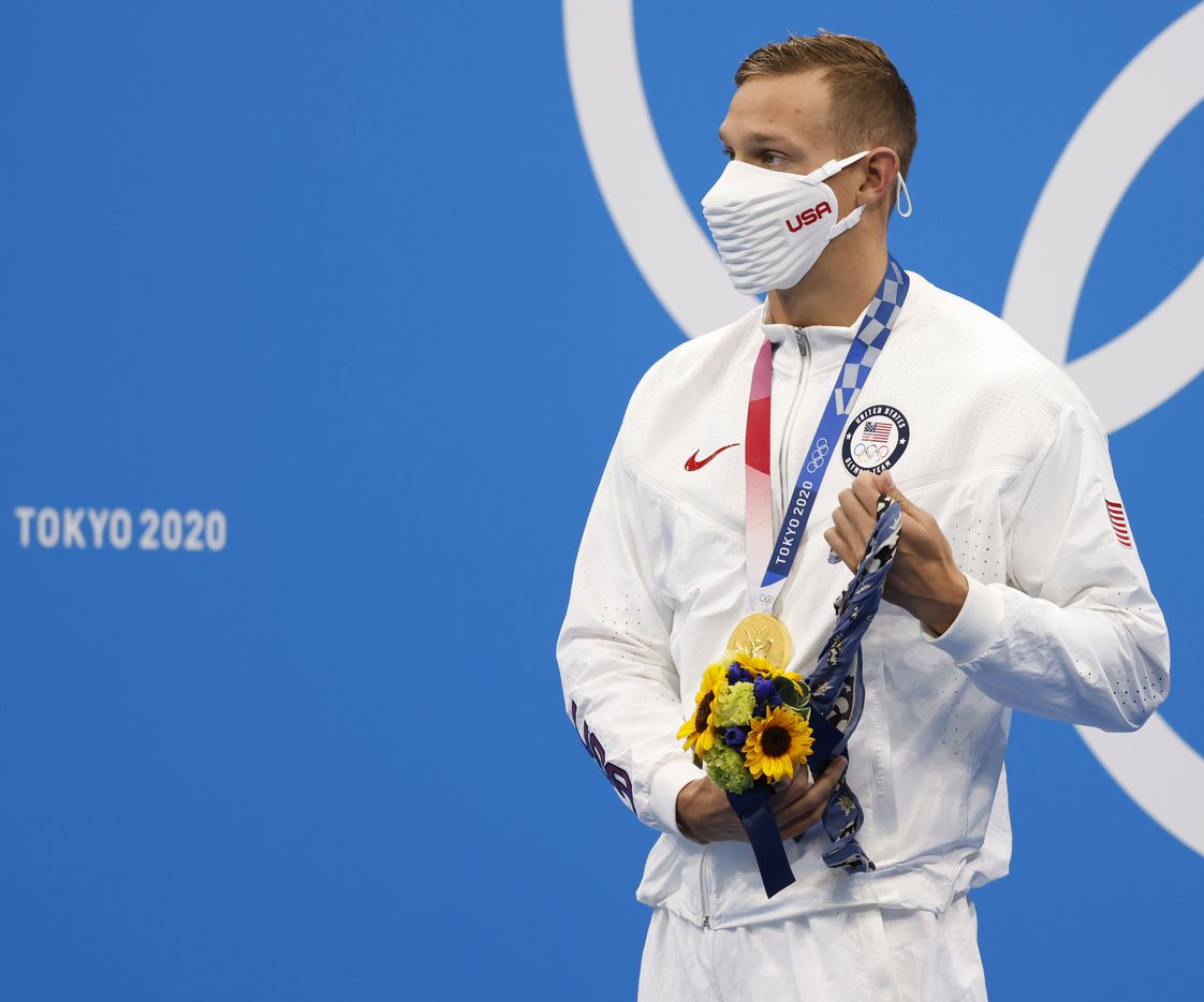 USA's Caeleb Dressel wraps fabric around his hand after receiving his gold medal during the medal ceremony for the men's 50 meter freestyle final during the postponed 2020 Tokyo Olympics at Tokyo Aquatics Centre, on Sunday, August 1, 2021, in Tokyo, Japan. Dressel earned a gold medal with a time of 21.07 seconds. (Vernon Bryant/The Dallas Morning News)