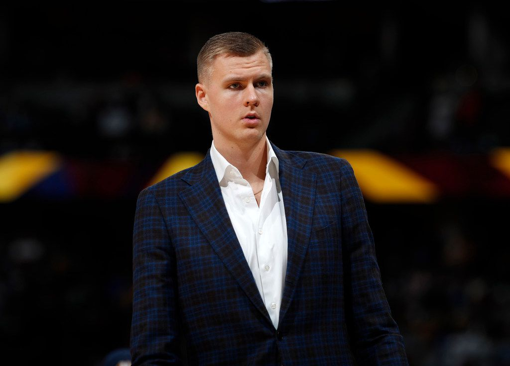 "FILE - In this March 14, 2019, file photo, Dallas Mavericks forward Kristaps Porzingis stands during the second half of the team's NBA basketball game against the Denver Nuggets in Denver. An attorney for Porzingis acknowledges that a woman has accused the NBA star of rape, but ""unequivocally"" denies the allegation. Lawyer Roland Riopelle said Saturday, March 30, that the claim against the Dallas Maverick was part of an extortion attempt that is being investigated by the FBI. (AP Photo/David Zalubowski, File)"