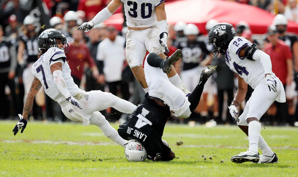 Iowa State running back Johnnie Lang (4) is upended between TCU defenders Trevon Moehrig, left, and Julius Lewis, right, during the second half of an NCAA college football game, Saturday, Oct. 5, 2019, in Ames, Iowa. Iowa State won 49-24. (AP Photo/Charlie Neibergall)