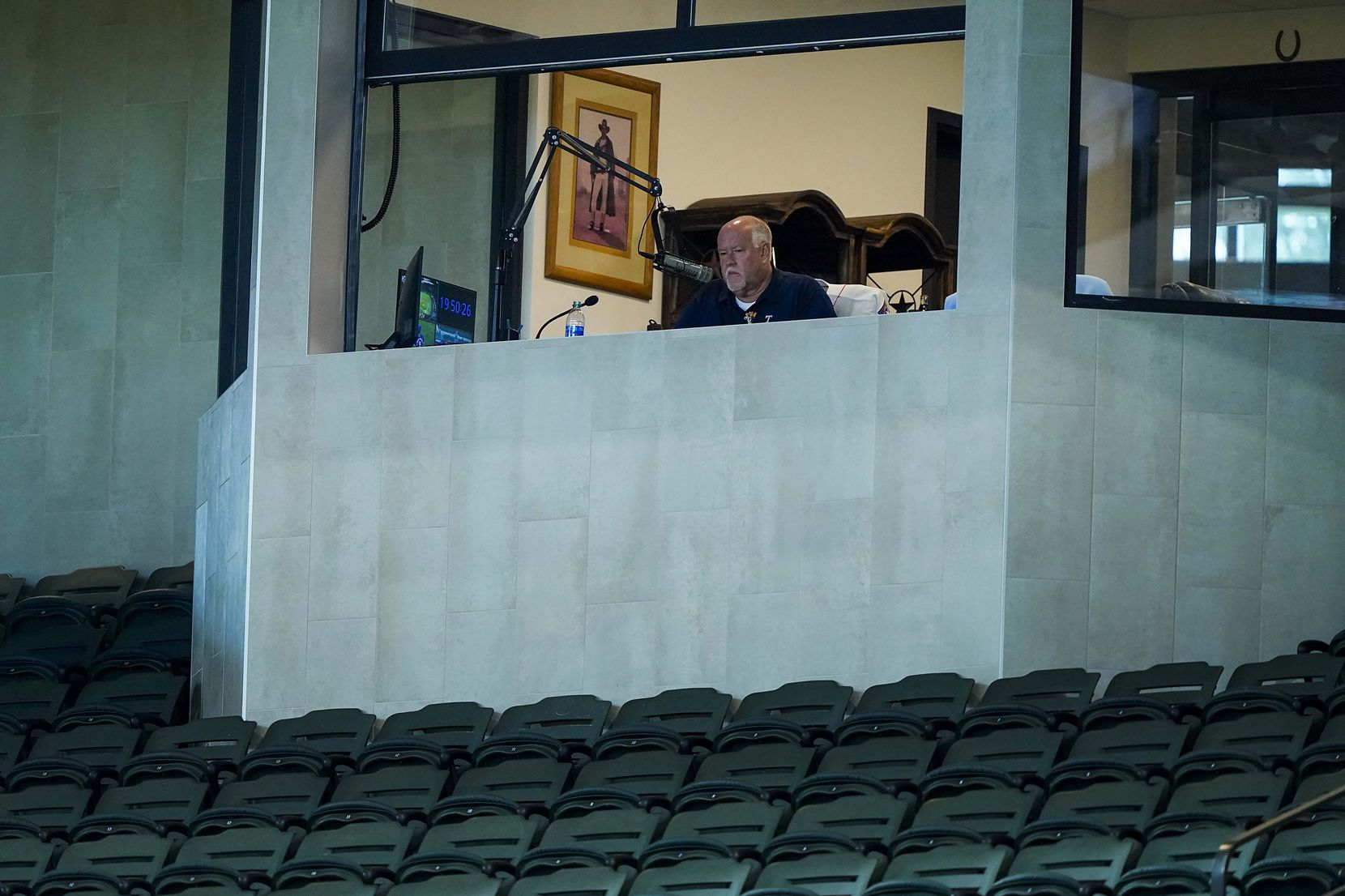Announcer Chuck Morgan works in his booth during Texas Rangers Summer Camp at Globe Life Field on Thursday, July 16, 2020.