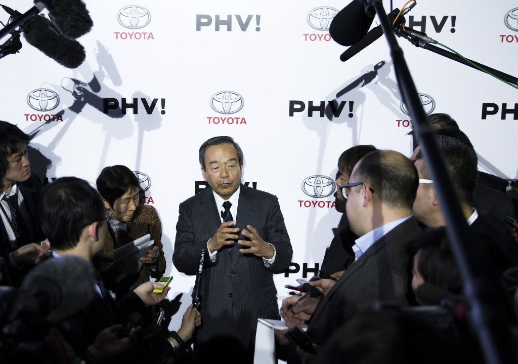Takeshi Uchiyamada, chairman of Toyota Motor Corp., speaks to the media after the sales launch for the company's new Prius plug-in hybrid vehicle. (Tomohiro Ohsumi/Bloomberg)