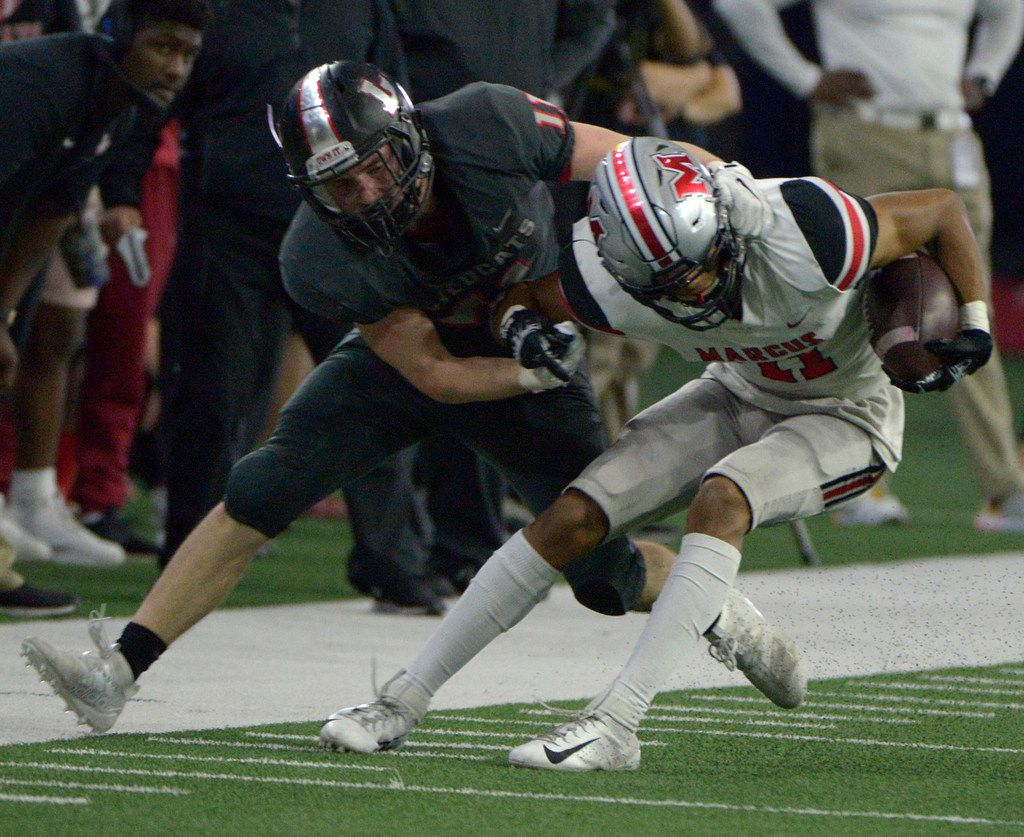 Lake Highlands' Graham Lavender (11) makes the tackle on Flower Mound Marcus' Dallas Dudley in the first half of a Class 6A Division II area round high school playoff football game between Flower Mound Marcus and Lake Highlands, Saturday, Nov. 23, 2019, in Frisco, Texas. (Matt Strasen/Special Contributor)