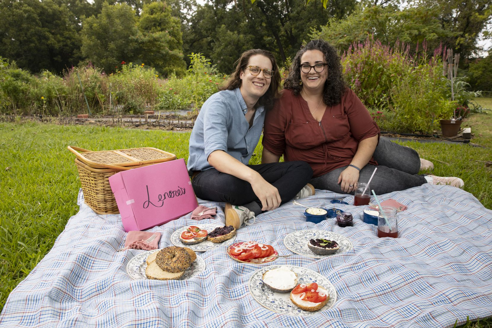 Seth and Jessica Brammer of Lenore's Bagels have a picnic at Bishop Hill Farm Flowers in Coppell.