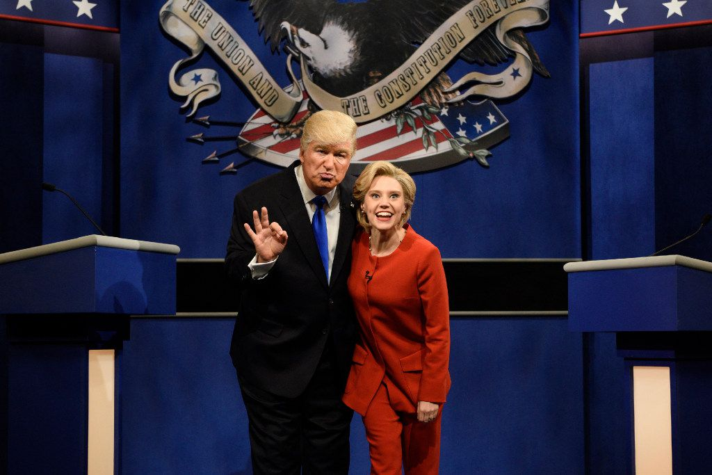 """In a Saturday, Oct. 1, 2016 file photo provided by NBC, Alec Baldwin, left, as Republican presidential candidate, Donald Trump, and Kate McKinnon, as Democratic presidential candidate, Hillary Clinton, perform on the 42nd season of """"Saturday Night Live,"""" in New York. (Will Heath/NBC via AP, File)"""