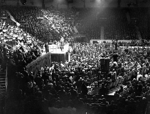 The Rev. Billy Graham stands on the rostrum at London's Harringay Arena on March 1, 1954. Plenty of people were suspicious when the evangelist arrived in London in February 1954 for a 12-week mission. But an estimated 2 million people attended the preacher's 72 rallies and up to 38,000 people responded to his altar calls.