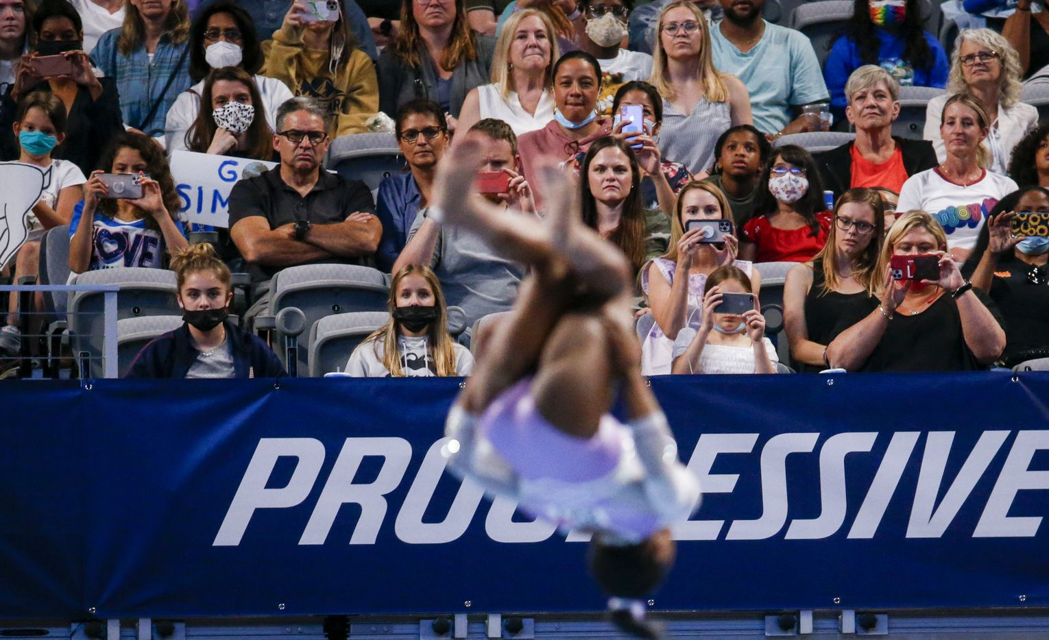 Fans watch Simone Biles perform on the floor during day 1 of the senior women's US gymnastics championships on Friday, June 4, 2021, at Dickies Arena in Fort Worth. (Juan Figueroa/The Dallas Morning News)