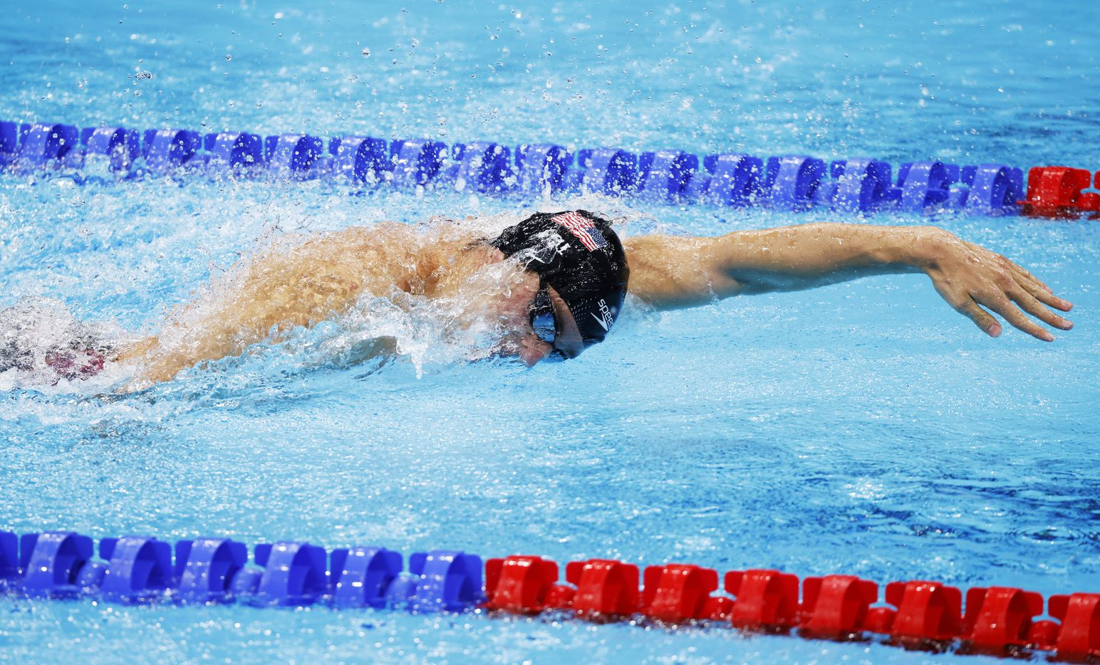 USA's Zach Apple competes in the men's 4x100 meter medley relay final during the postponed 2020 Tokyo Olympics at Tokyo Aquatics Centre, on Sunday, August 1, 2021, in Tokyo, Japan. USA earned a gold medal, setting a new world record with a time of 3:26.78. (Vernon Bryant/The Dallas Morning News)