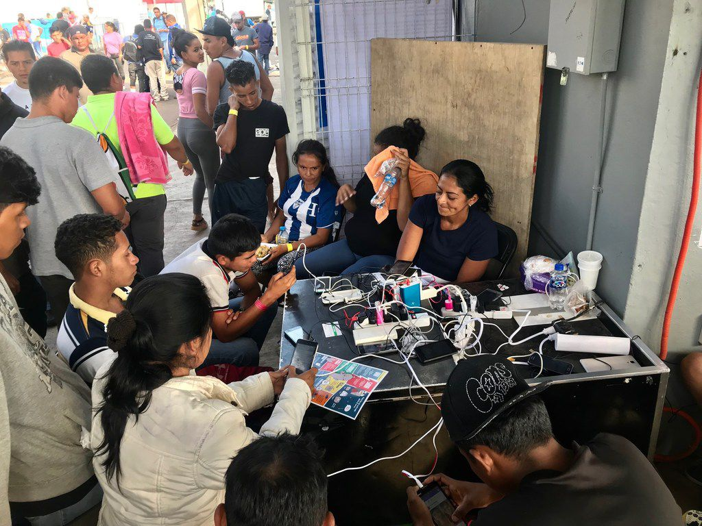 The Mexico City government is providing some 18,000 meals a day for Central Americans inside the stadium as well as dental services and even a table that serves as a cell phone charging station.