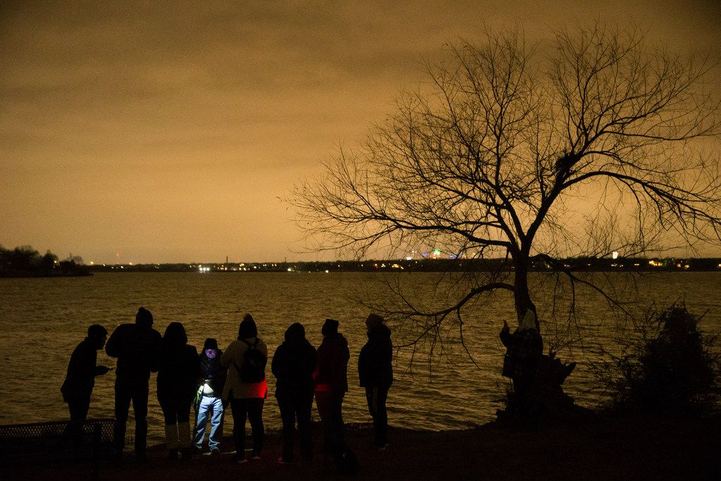 People looking to see if White Rock Lake is haunted, explore the lake with Haunted Rooms in Dallas on Friday, December 14, 2018. The group used various equipment to detect if ghosts were in the area. (Daniel Carde/The Dallas Morning News)