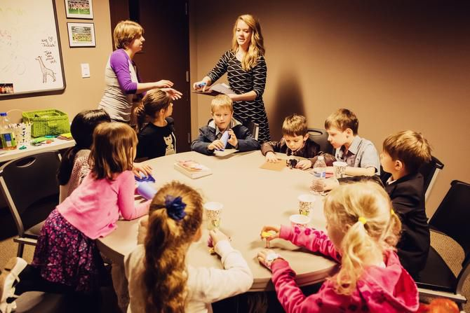 Stephanie Swain, River of Life Sunday School Director, left, and volunteer Elizabeth Vedernikov, work with children of Russian-speaking immigrants who attend the church.
