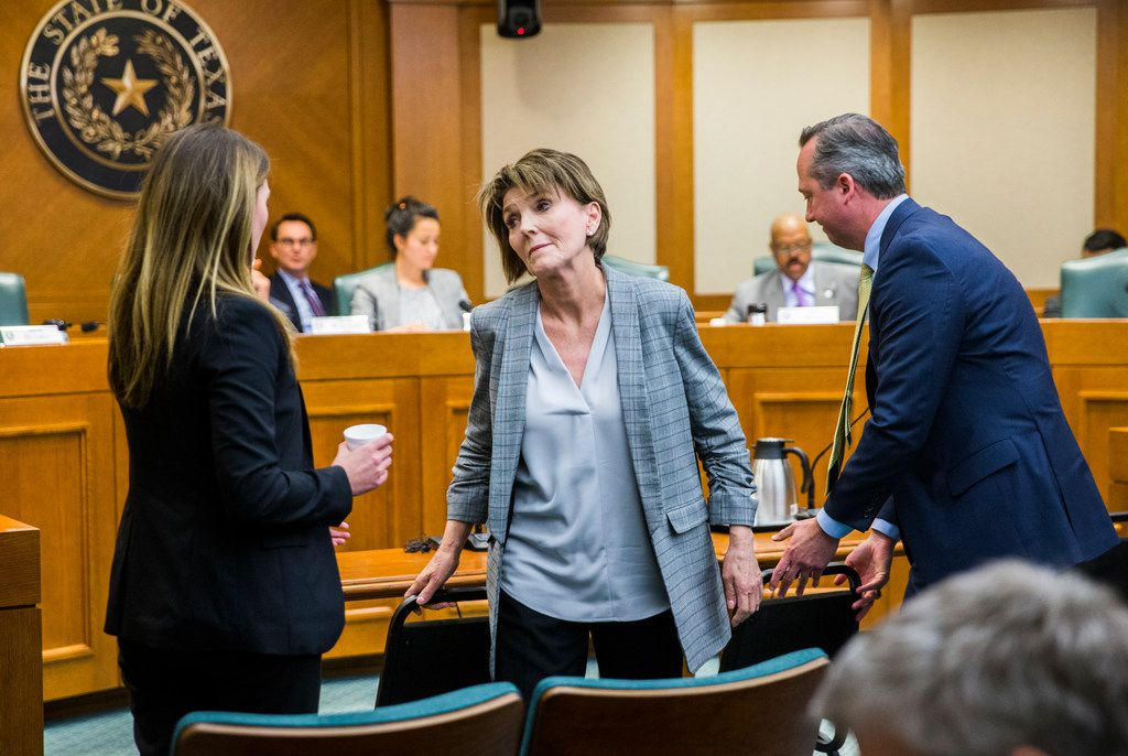 Eve Wiley (left) and her mother, Margo Williams (center), react after testifying before the Senate Criminal Justice Committee last week. At right is Wiley's advisor Kris Heckmann of Granite Public Affairs.