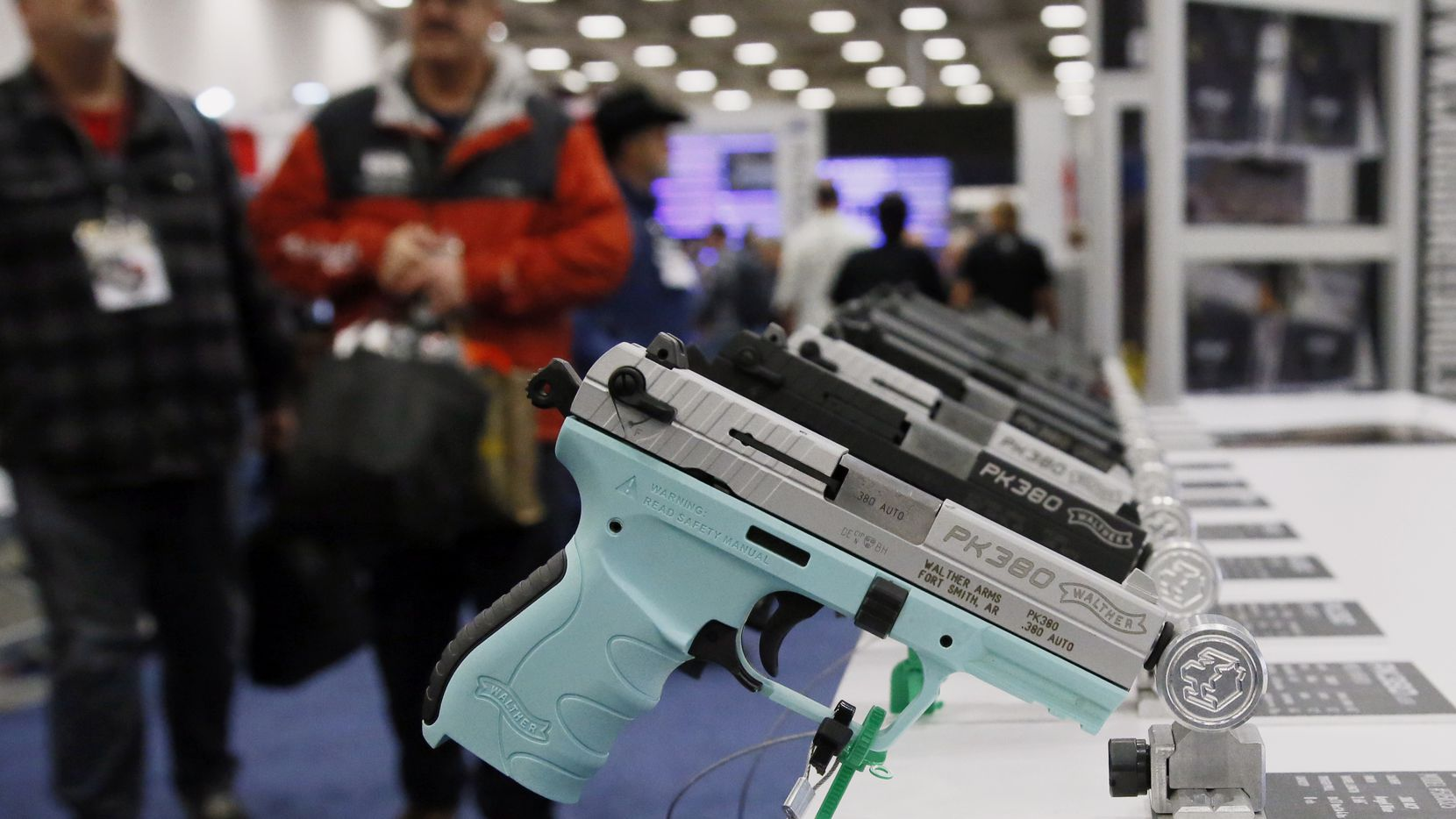 FILE - In this May 4, 2018, file photo, handguns are on display at the The National Rifle Association convention in Dallas. Texas is edging closer to becoming the largest state in the country to allow people to carry handguns without a license. (AP Photo/Sue Ogrocki, File)