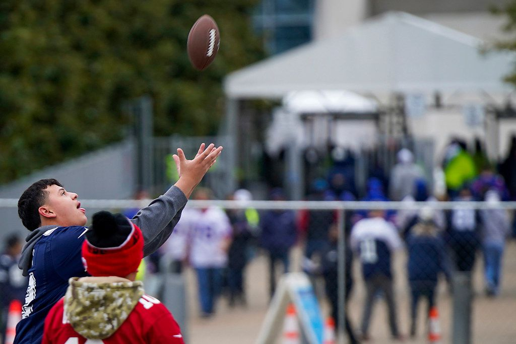 Fans toss a football in the parking lot as they tailgate before an NFL football game between the Dallas Cowboys and the Buffalo Bills at AT&T Stadium on Thursday, Nov. 28, 2019, in Arlington. (Smiley N. Pool/The Dallas Morning News)