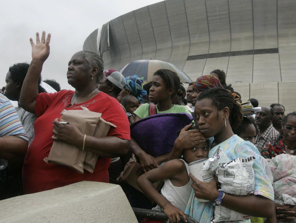 Dianne Wallace, left,  Alexis Fisher, 14,  Dejon Fisher, 8, and her mother Cavel Fisher Clay, 33, got a little unnerved as they waited in a hostile line at the New Orleans Superdome to get onto busses to the Houston Superdome on Thursday, September, 01, 2005, days after Hurricane Katrina flooded New Orleans.