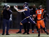 Frisco Lone Star wide receiver Trace Bruckler (4) hauls in a first quarter touchdown pass against Lancaster defensive back Theron Stoops (13) during their Class 5A Division I Regional championship at Wilkerson-Sanders Stadium in Rockwall, Texas, Friday, December 6, 2019. (Tom Fox/The Dallas Morning News)