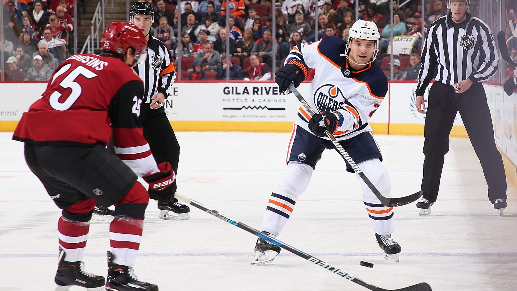 GLENDALE, AZ - JANUARY 12:  Andrej Sekera #2 of the Edmonton Oilers passes the puck around Josh Archibald #45 of the Arizona Coyotes during the second period of the NHL game at Gila River Arena on January 12, 2018 in Glendale, Arizona.  (Photo by Christian Petersen/Getty Images)
